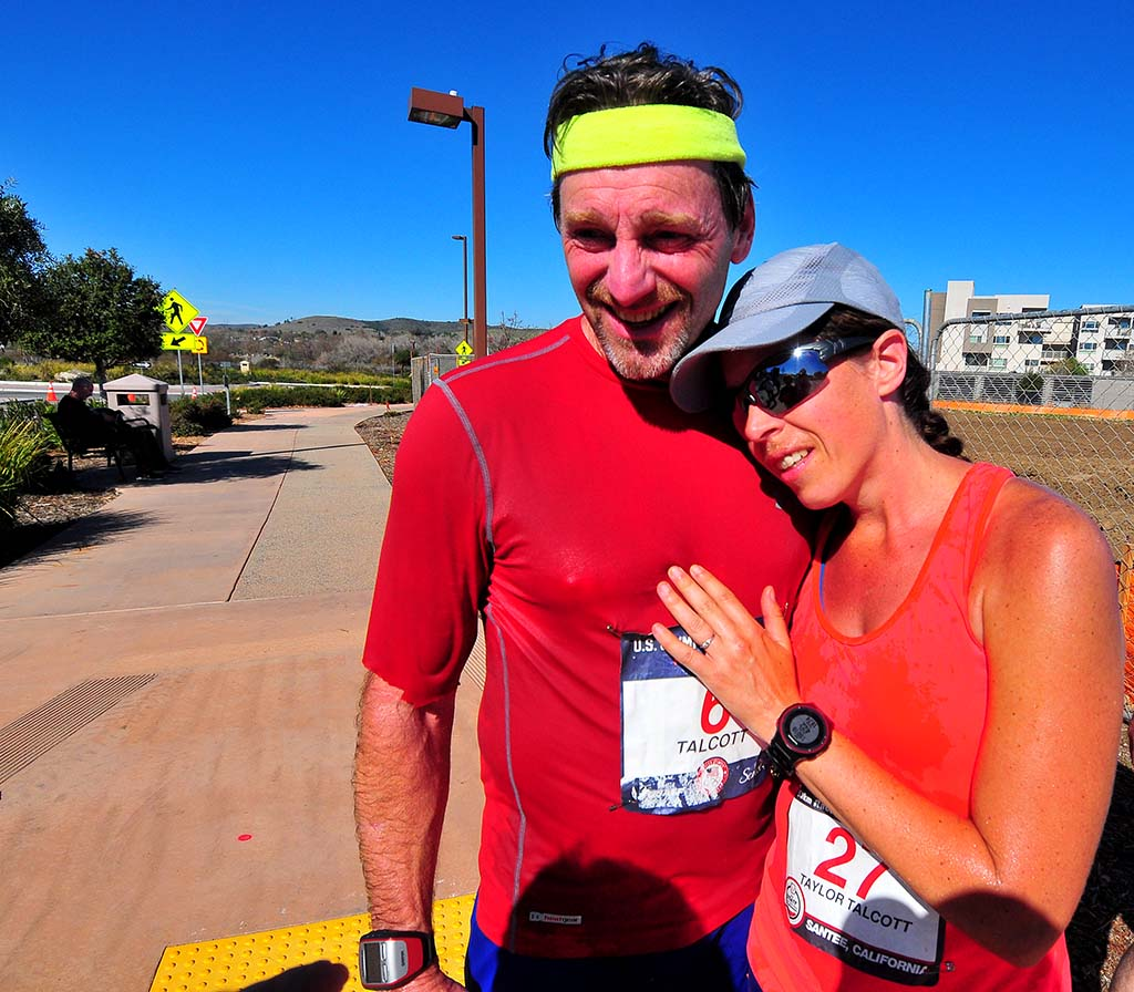 Husband-and-wife walkers Dave Talcott, 59, and Erin Taylor-Talcott, 41, celebrate his seventh-place finish in 5:06:52 and hers in a runner-up 4:47:01.