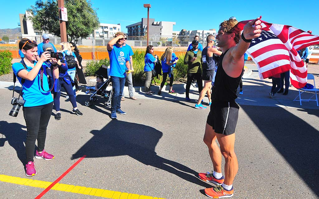 Nick Christie displays Old Glory won with a third-place finish at the Olympic Trials 50K walk.