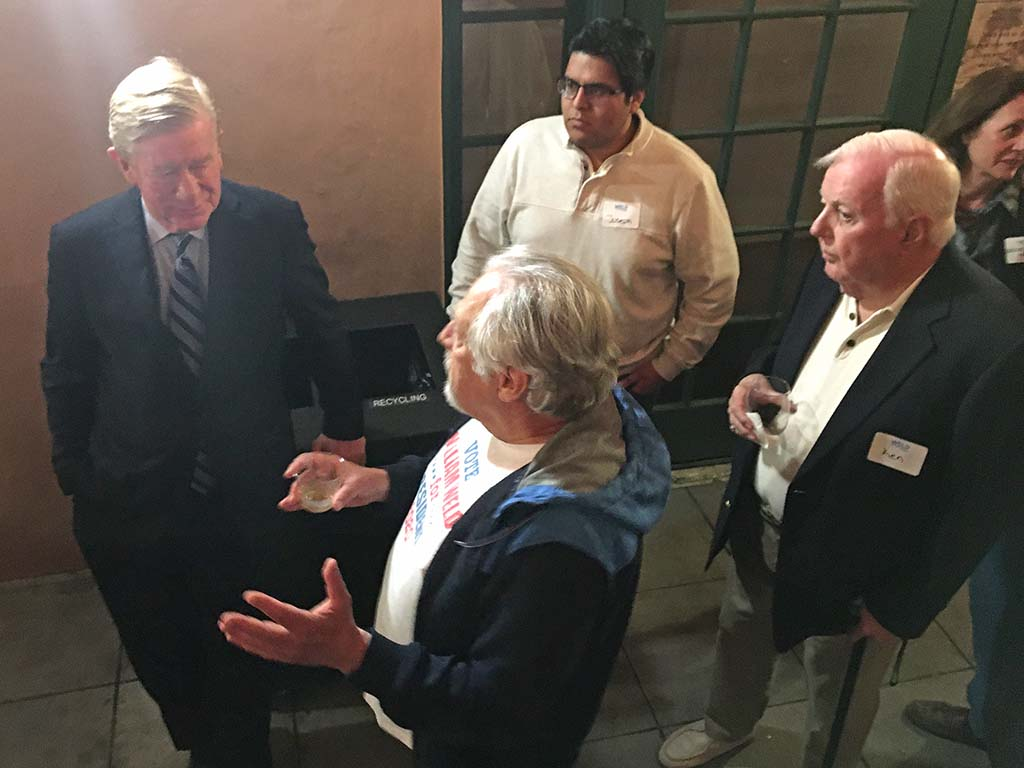 Bill Weld listens to questions at a wine-and-beer mixer advertised via a Facebook events page and email to former donors.