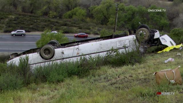 Bus in fatal crash ended up on roof off Interstate 15.