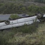 Bus wreckage on freeway enabankment