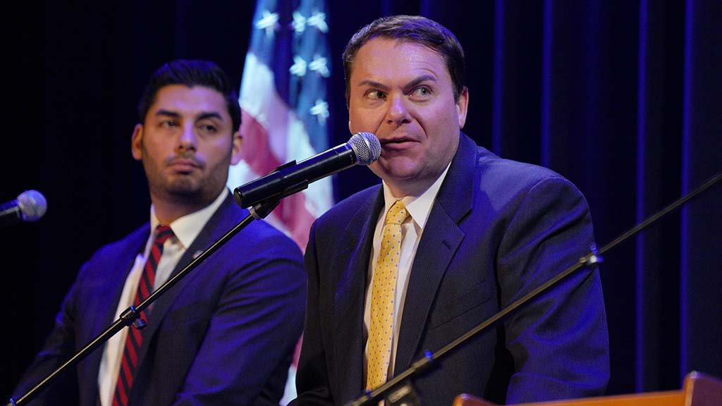 Ammar Campa-Najjar (left) eyes Carl DeMaio, who pledged to keep the U.S. commitment to seniors that they'll get Social Security.