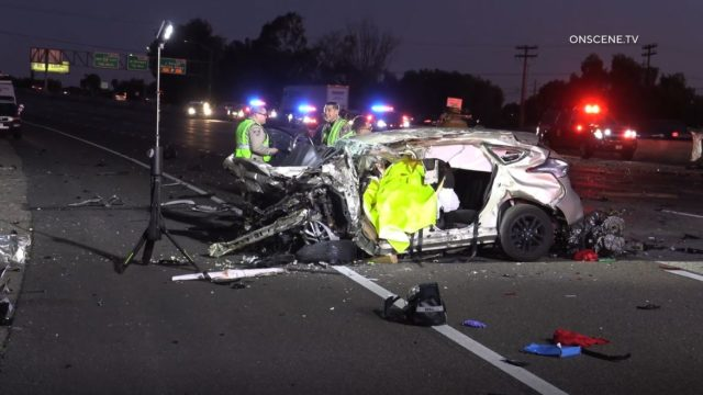 CHP officers examine vehicle wreckage