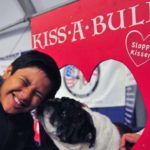 Matthew Munger, 12, of Oceanside visits the Kiss A Bull booth at the Meet the Breeds area.