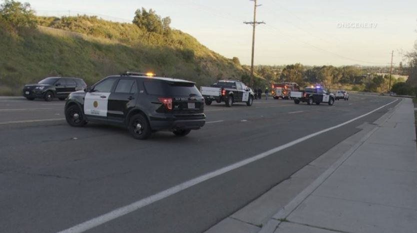 Police vehicles at the scene of the shooting