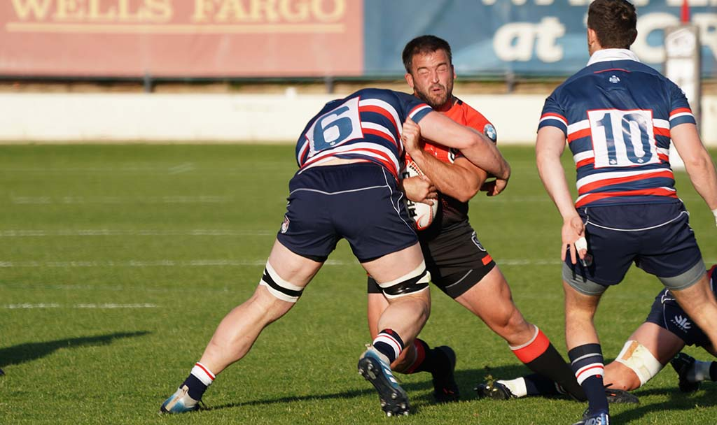 A San Diego Legion player is stopped in his tracks as he advances toward the goal.