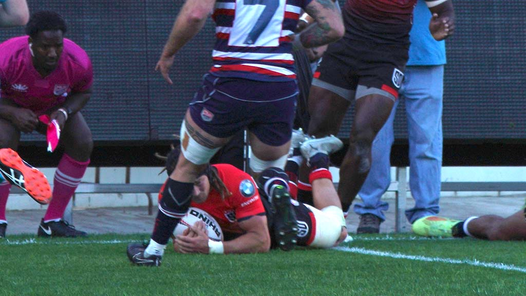 Dylan Audsley scrambles across the line to make a try late in the first half.