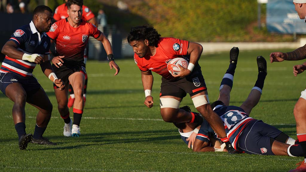 Tevita Tameilau advances the ball in the first half of the game.