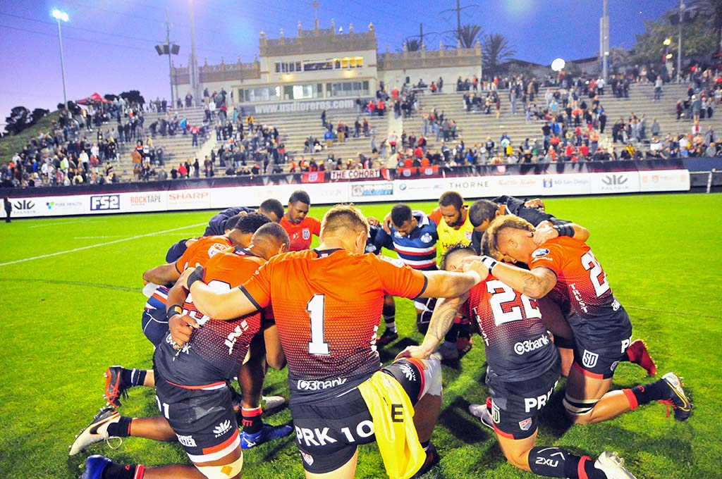 Players pause to pray after the match in which they won their third consecutive game.