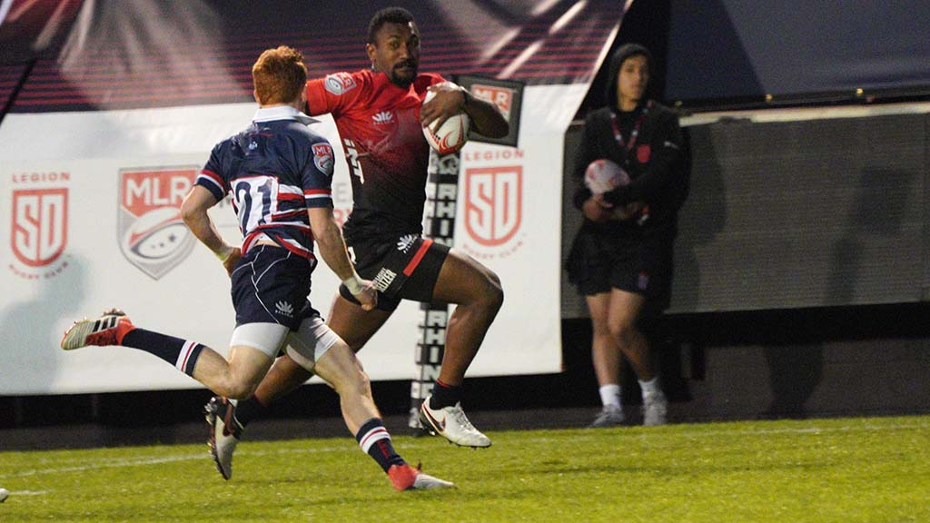 Legion Wing Tira Patterson runs in a try in the first half of the match against the New England Free Jacks.
