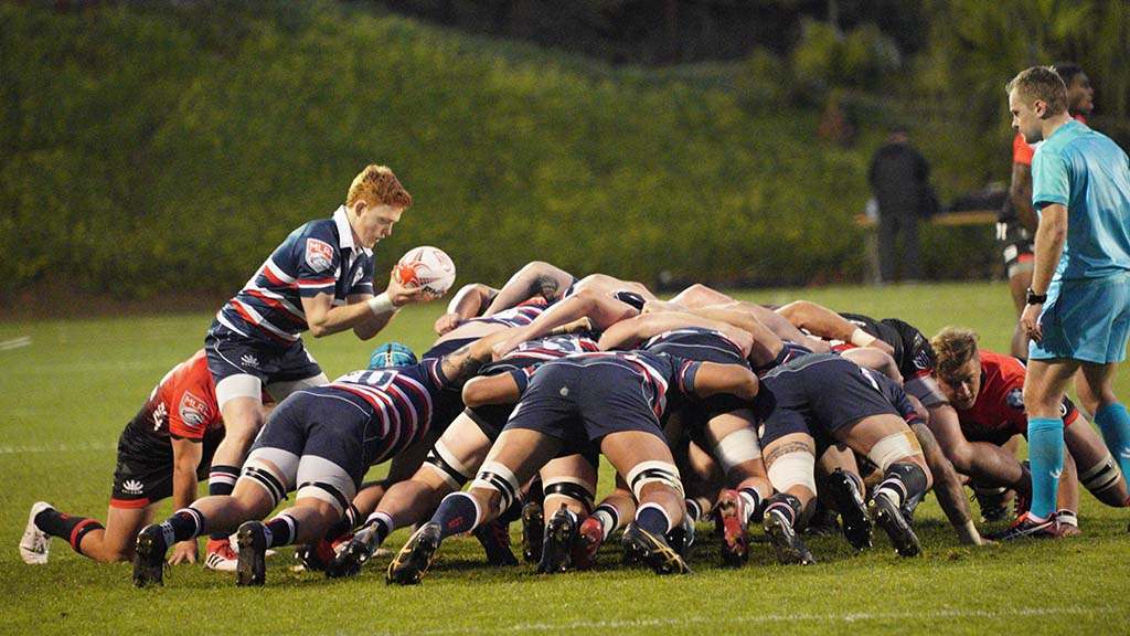 A player for the New England Free Jacks prepares to set the ball in the scrum