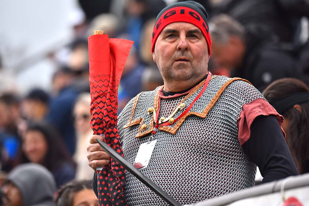 A member of the Cohort — Legion fans who dress in medieval garb — readies himself for the second half of the rugby match.