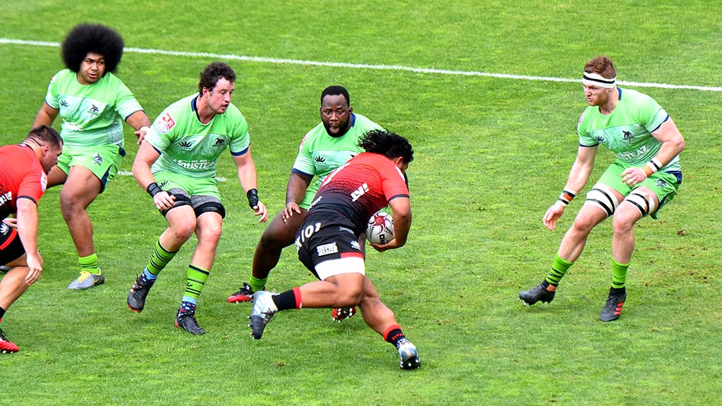 Legion player Oti Pifeleti attempts to make a try during the first half of the match.
