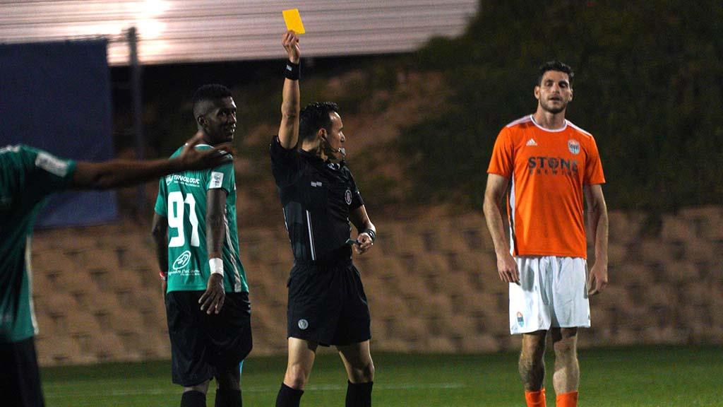 Adonis Villanueva from Costa Del Este FC gets a warning from a referee.