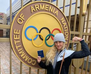 Allison Halverson with her passport at offices of the Armenian Olympic committee.
