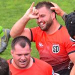 Dean Muir (center) celebrates scoring a try in the first half of the Legion rugby game.