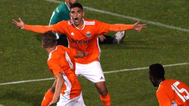 A Loyal player reacts after the goal made by Jack Metcalf.