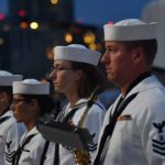 Members of the Navy Band Southwest stand at attention during the playing of taps in 2019.