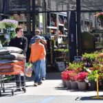 Customers continued to buy home and garden supplies at Home Depot off Mission Gorge Road.
