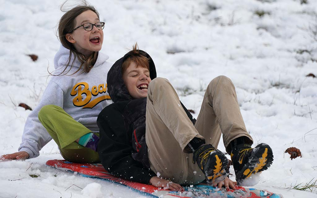 A San Diego family with four children enjoy taking to the snowy slopes rather than remain at home.