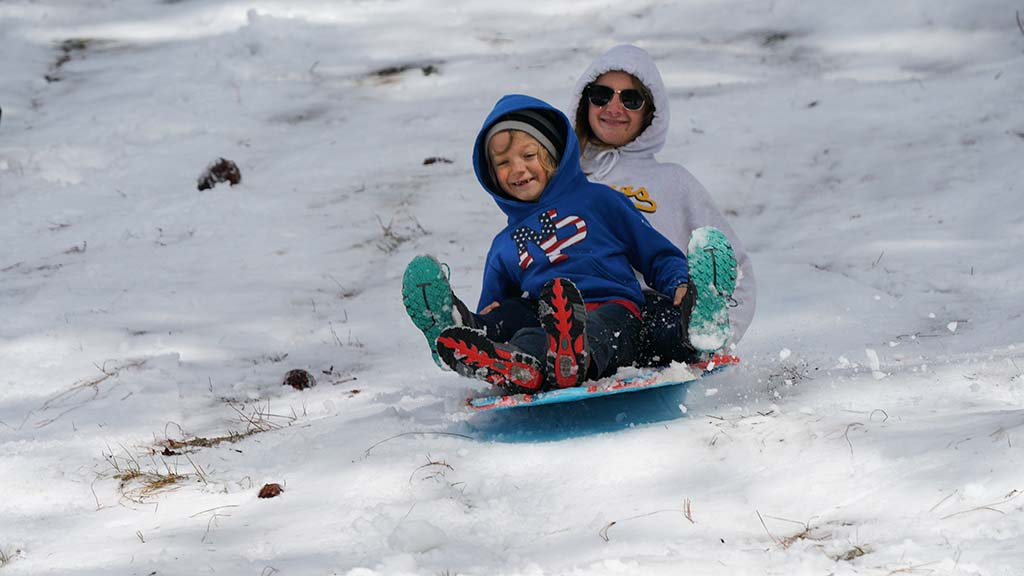 A San Diego family delighted in social distancing from others in the snowy Laguna Mountains.