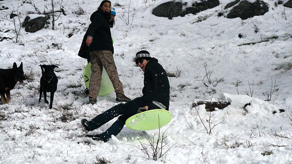 Cameron Rollin of Jamul sleds in the Lagunas, saying he was tired of being inside. Photo by Chris Stone