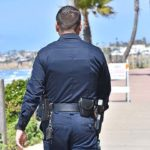 A San Diego policeman was busy telling people that the Pacific Beach boardwalk is closed.