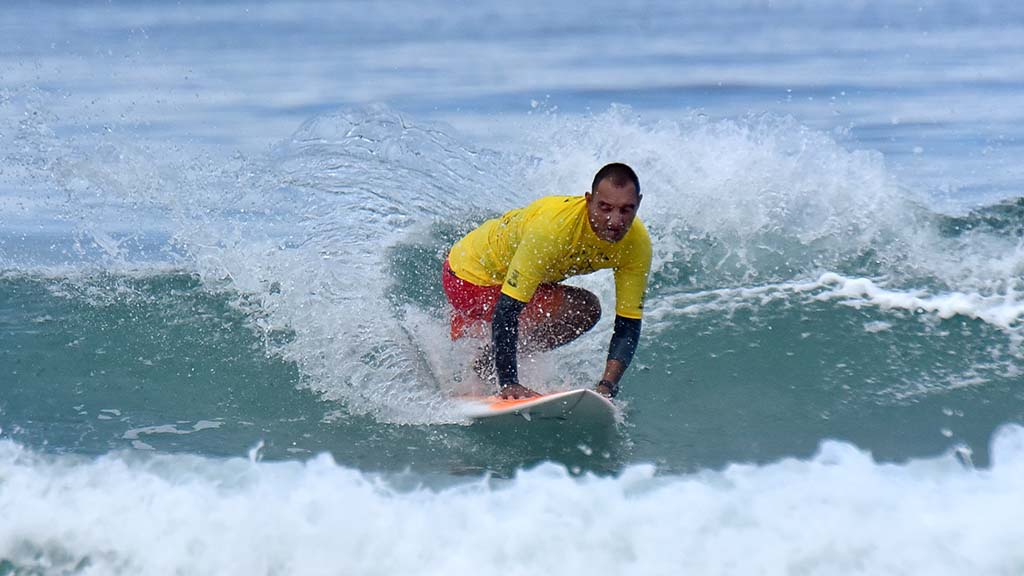 Alcino Neto of Brazil turns on a wave in the kneel category of the Ampsurf 2020 ISA World Para Surfing Championship on La Shores Beach.