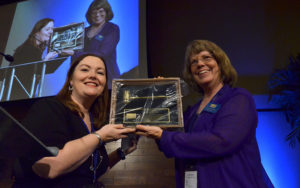 As outdoing Press Club president, Pauline Repard (right) was presented gavel by  her successor, Kristen Castillo.