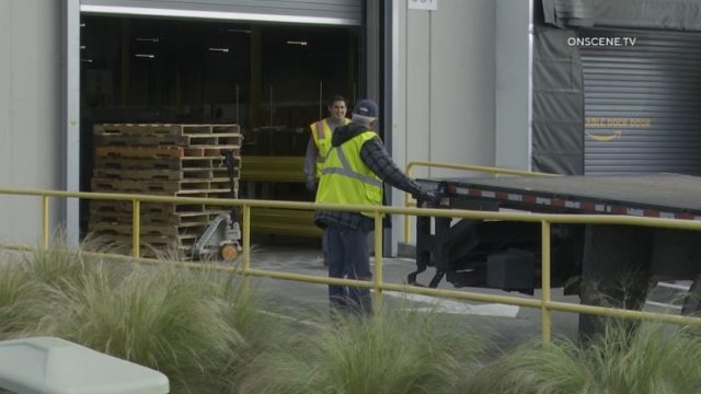Workers at a warehouse in National City