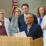 Dr. Wilma Wooten briefs the media