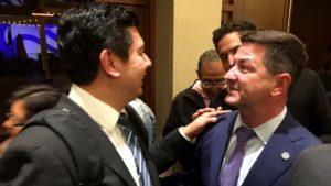 Former Councilman David Alvarez (left) greets outgoing Councilman Chris Ward at Democrats' watch party at The Westin.