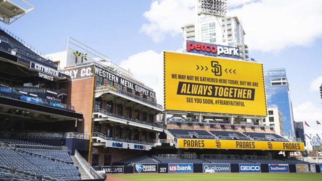 "Amid empty stands, the San Diego Padres displayed a sign: ""We may not be gathered here today, but we are always together."""
