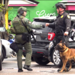 San Diego police greet each other with a fist bump during long standoff with apparently suicidal gunman.
