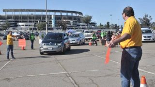 Todd Walters, president of UFCW Local 135, directs traffic at the food giveaway at SDCCU Stadium.