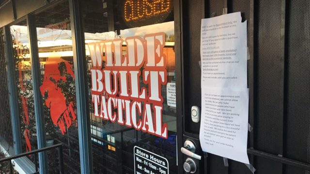 Wilde Built Tactical, a La Mesa gun shop on Lake Murray Boulevard, is closed buy displays a note saying it can open by appointment. Photo by Ken Stone