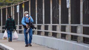 U-T photographer John Gibbins, wearing protective mask, walks near U.S.-Mexico border on Friday. Courtesy photo