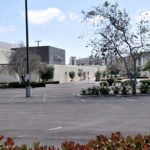 Mall parking lots, normally full on weekend, remain empty.
