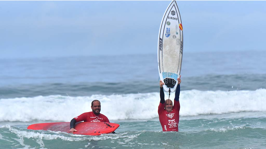 Aitor Francesena or Spain celebrates with his caddy Lukas Garcia after winning in the visually impaired category at the Ampsurf 2020 ISA World Para Surfing Championship on La Shores Beach.