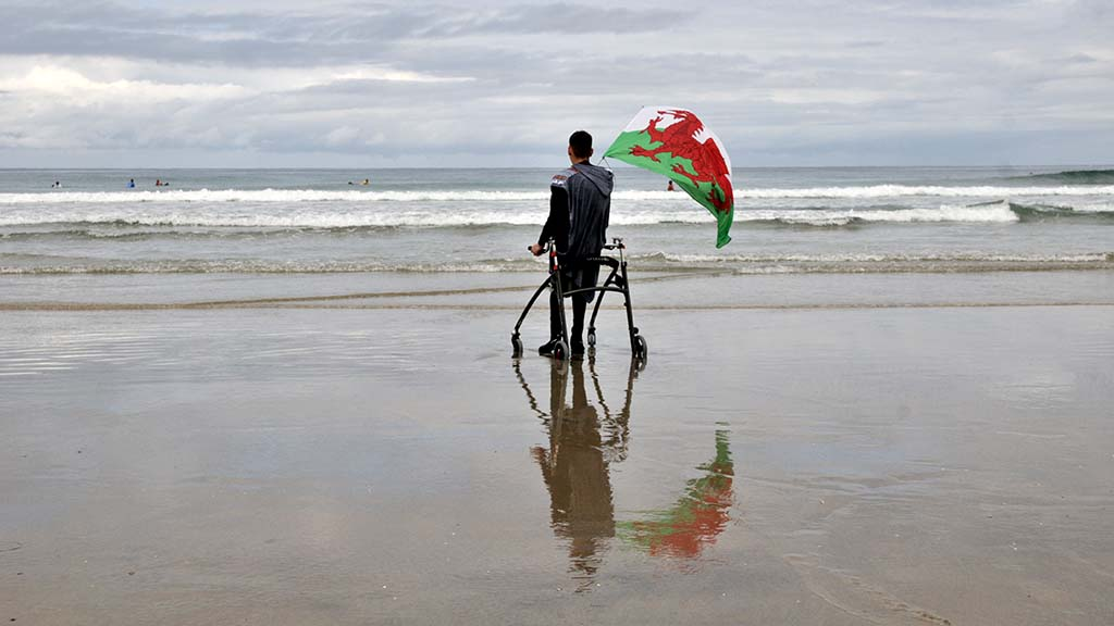 A para-surfer from Wales cheers for a compatriot competing in Ampsurf 2020 ISA World Para Surfing Championship on La Shores Beach.