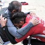 Apple Valley's Jose Martinez (right) and Buster Kawasaki of Hawaii embrace after finishing their semifinal heat at the Ampsurf 2020 ISA World Para Surfing Championship at La Shores.
