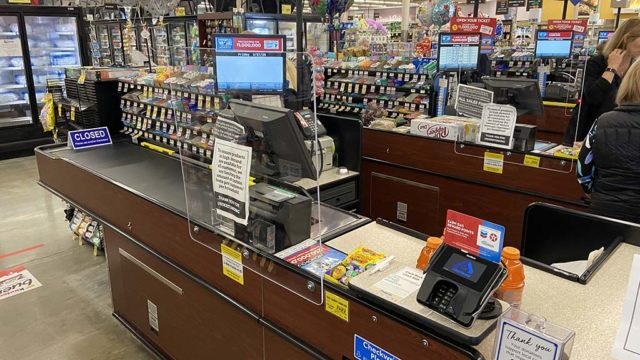 """Plexiglass """"sneeze panels"""" like this one at a San Marcos Albertsons are being installed at chain and other unionized grocery stores."""