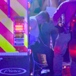 Suspect XXX sits handcuffed after U-haul rental van hoit several people anmd crashed into Encinitas bar.