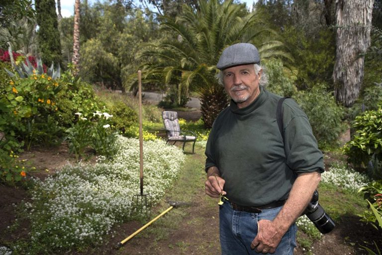 """Don Bartletti is shown in the Vista garden he's nurtured for 59 years. The retired Los Angeles Times veteran spends much of his """"sequester-at-home"""" time maintaining and photographing his 1-acre sanctuary."""