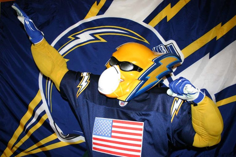Dan Jaregui, the former Chargers mascot Boltman, wears a mask over his mask at home.