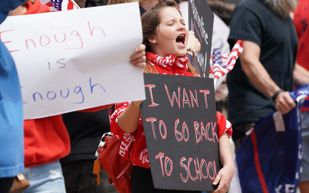 Children raised their voice at the rally to end mandatory closings.
