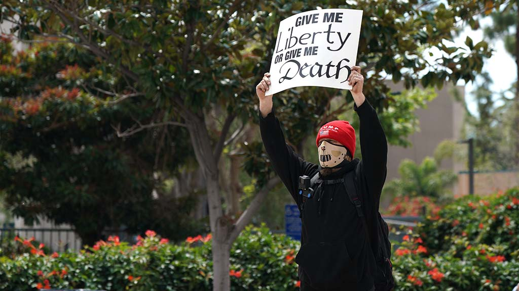 """Several people showed the Patrick Henry slogan """"Give me liberty or give me death."""