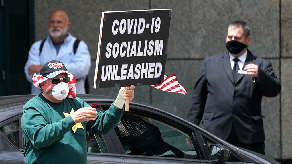 One protester linked COVID-19 restrictions with socialism.