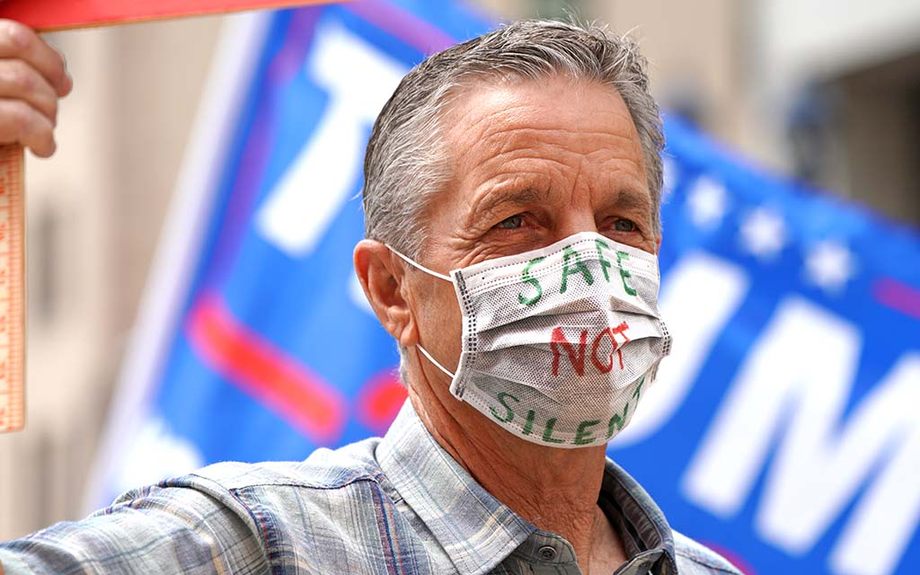 A protester in downtown San Diego lets his mask speak for himself.