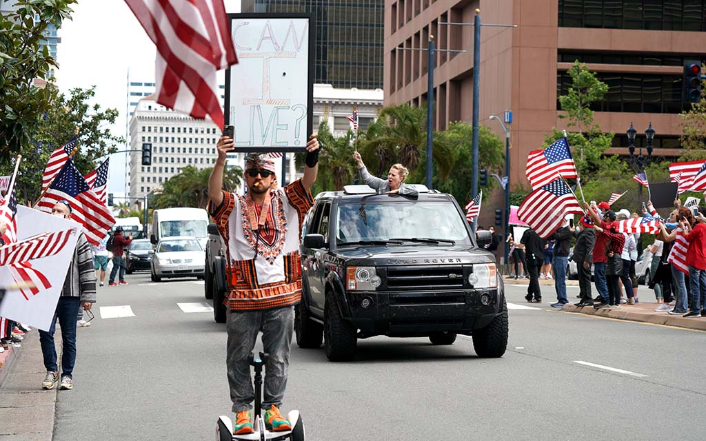 A protester rides a hoverboard down Broadway and State Street to express his opinion.